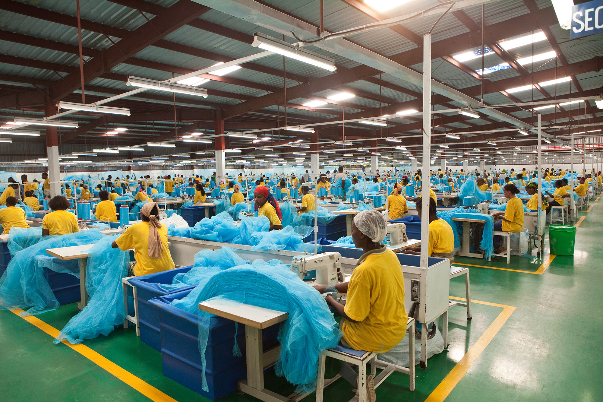 Employees of A to Z Textile Mill manufacture durable mosquito nets in a factory outside Arusha, Tanzania.