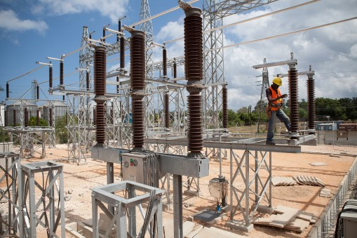 An engineer inspects an electrical substation in Zanzibar.