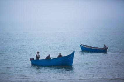 Fishing boats at sea off the coast of Agadir, Morocco.