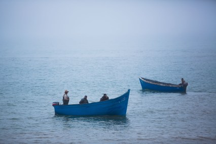 Fishing boats at sea off the coast of Agadir, Morocco.