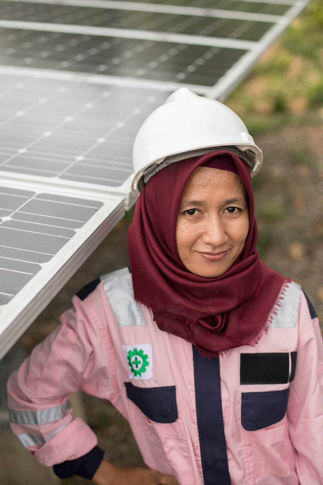 Junior electrical technician, Verawati (23), inspects and maintains solar panels on Karampuang Island, Indonesia.