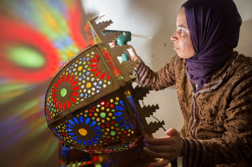 An artisan builds a decorative lamp in Fez, Morocco.