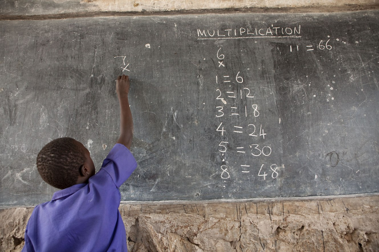 A student learns mathematics in Amuria District, Uganda.