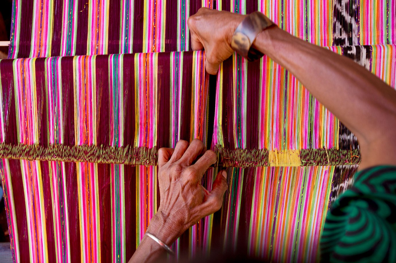 A woman weaves a traditional cloth in East Timor.