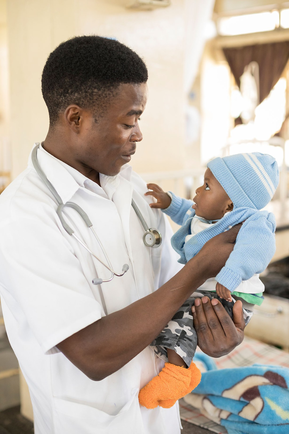 A nurse cares for a pediatric patient at a hospital in Kitwe, Zambia.