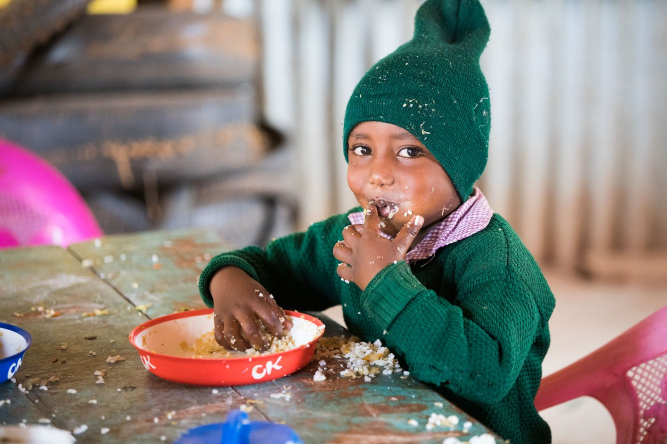 A kindergarten student eats lunch in Nairobi, Kenya.