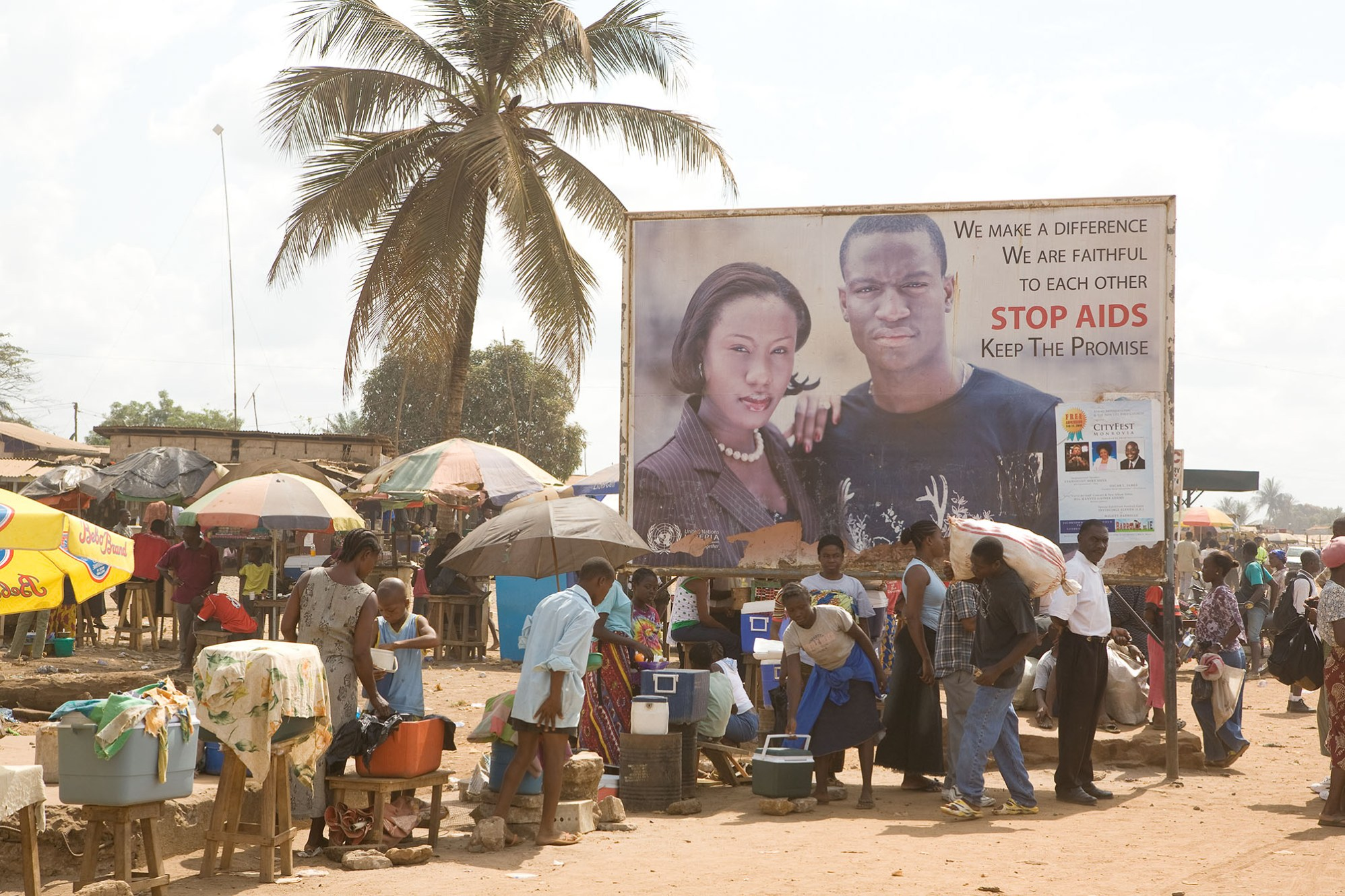 A public service advertisement warns of the risks of HIV/AIDS in Monrovia, Liberia.