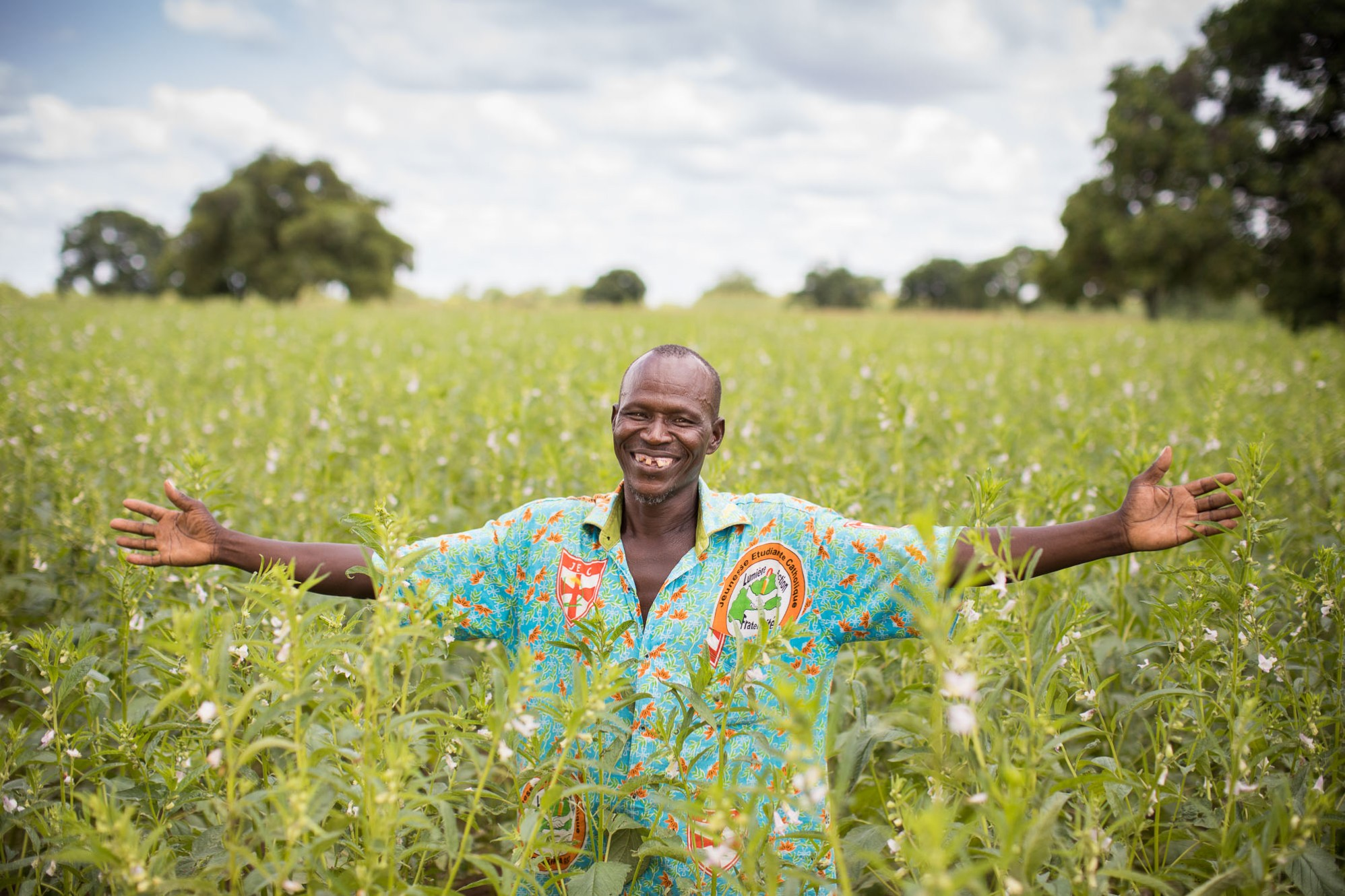 A farmer basks in his sesame fields in Boucle de Mouhoun Province, Burkina Faso.