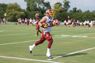 Joe Kerridge runs up the sideline. (Photo by Jake Russell)