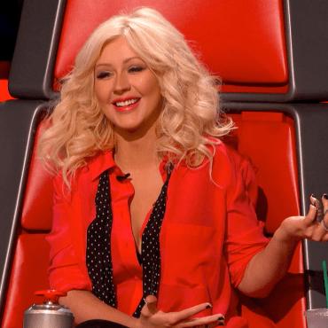 """Christina Aguilera smiles on """"The Voice"""""""