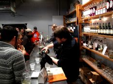 Wes pours a sample to taste.
