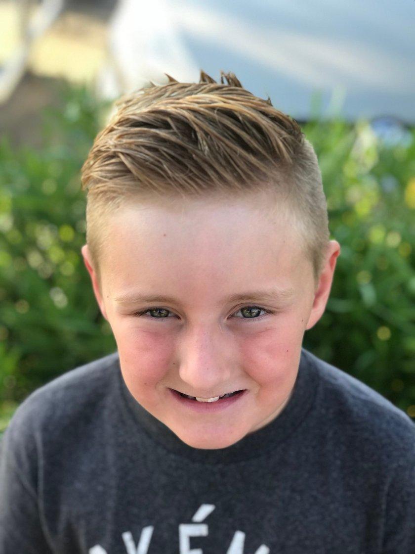 This kid got a haircut,…