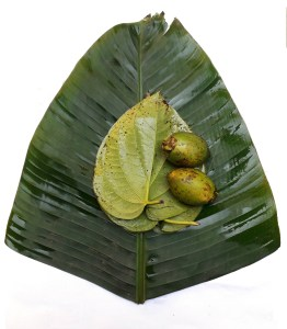 Two nos. of tamul (betel nut) and two nos. of pan (betel leaf) on Kalpat (banana leaf)
