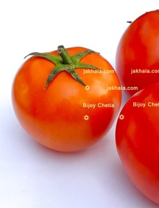 a tomato beside two tomatoes