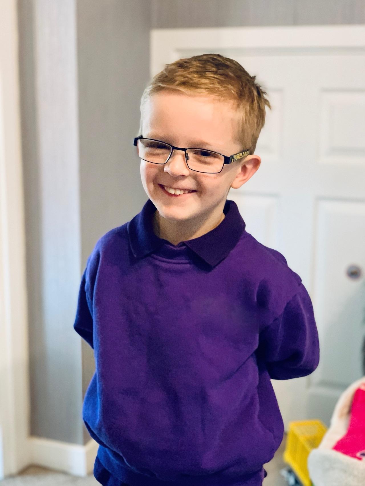 my little man wears glasses