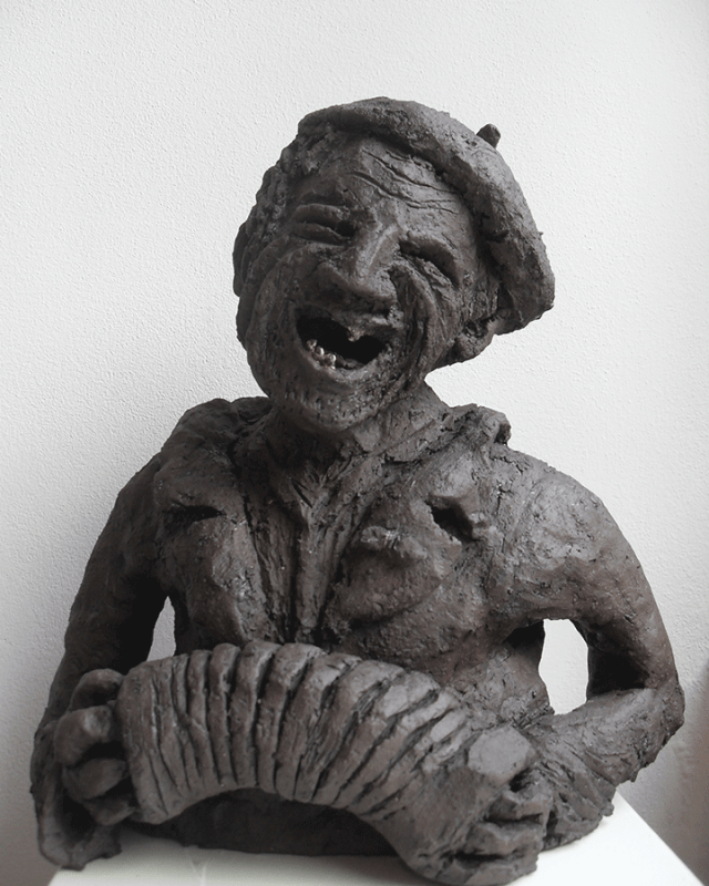 Clochard-muzikant 35cm hoog, 25cm breed