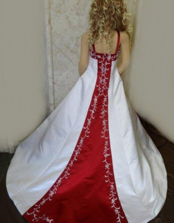 White miniature wedding, flower girl dress with colorful red, accented with and white embroidery running down the train.