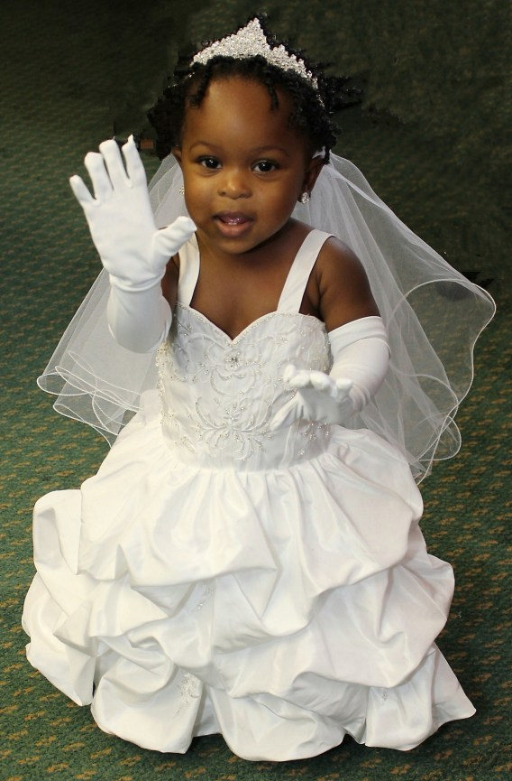 Look at this precious little flower girl all dressed up for this special day.