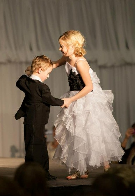 White and black floor length ruffle layered party dress. Fully lined with additional netting under the skirt.