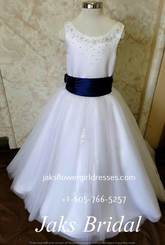 white flower girl dress with blue sash