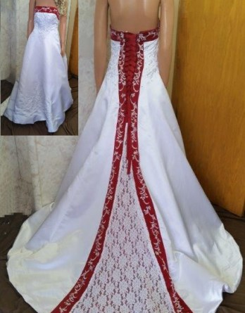 White dress for wedding flower girls. Red trimmed neckline, lace up back and chapel train with beaded embroidery.