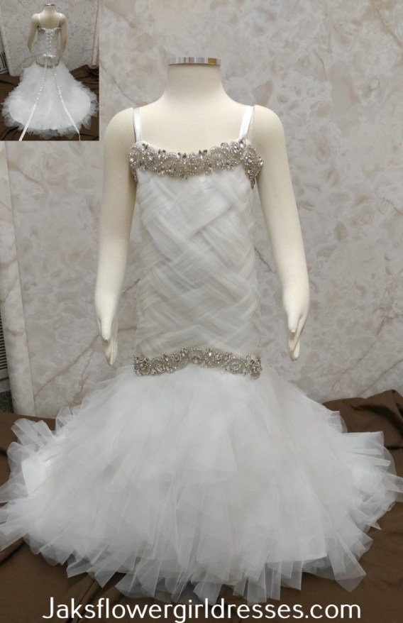 Tulle trumpet flower girl dress with ruffle skirt, and jewel trim.