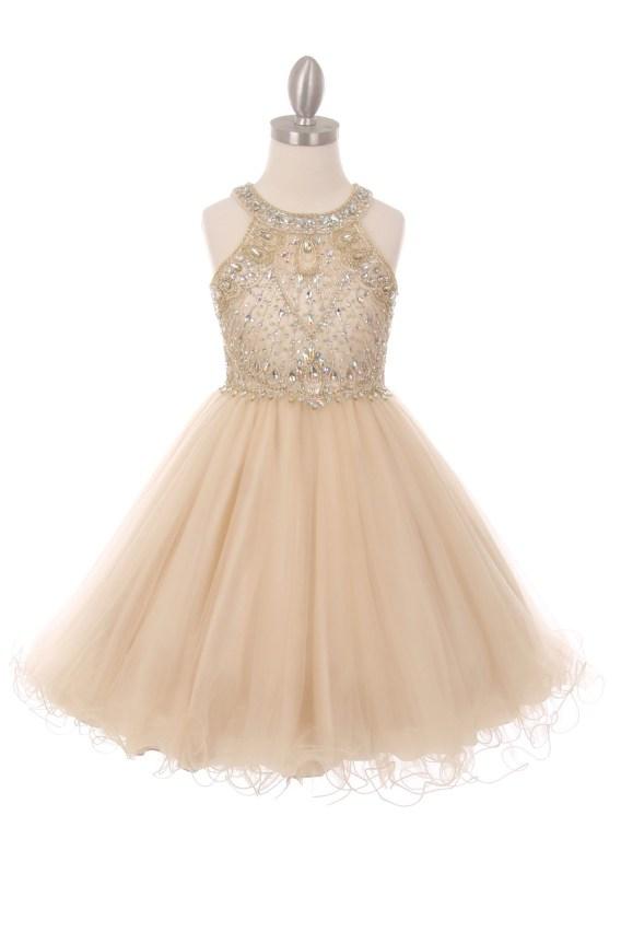 Champagne girls rhinestone dress with open back.