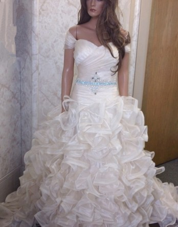 Ruffle wedding dresses. Off shoulder dress with beaded waist