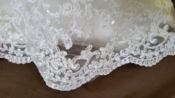 lace trimmed flower girl dress train
