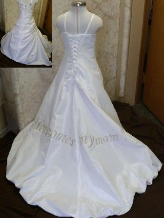 baby wedding dress with here comes my mom embroidered on train.