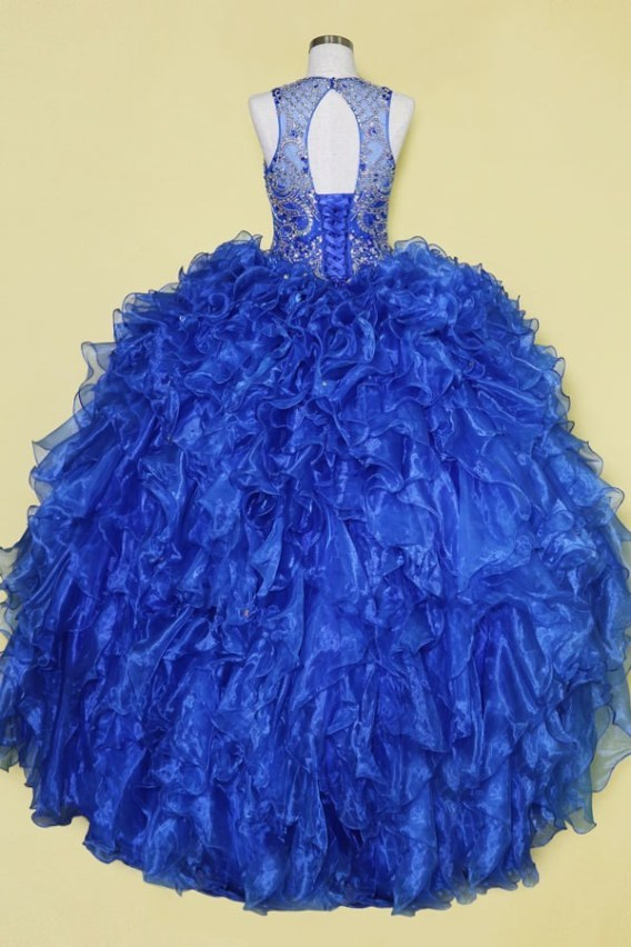 Sleeveless prom dress ball gown. Sheer illusion sweetheart dress with beading, ruffle layered skirt and open back.
