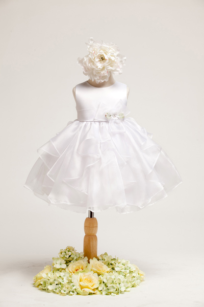 Lovely white baby dress. Sleeveless satin bodice with organza ruffle skirt. Flower decoration on the side of waistband.