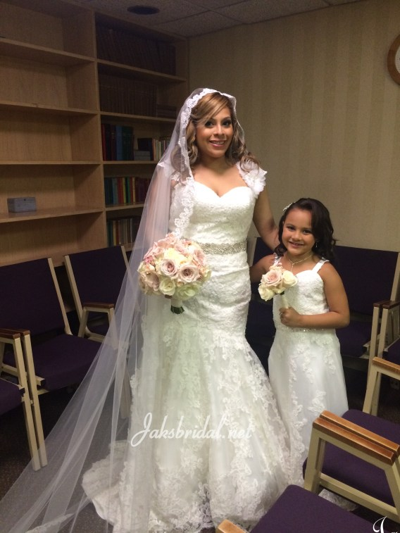 bridal gown and matching flower girl