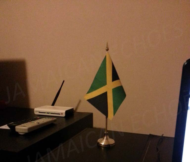 I carry a piece of Jamaica with me wherever I go. Here's my desk Jamaican flag in my Beijing apartment.