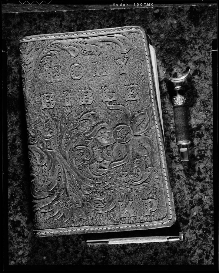 Still life photo of Kay's Bible cover that I made her when we were first married. Carved out of leather. Shot with Toyo VX-125 on Kodak TMAX-100 film.