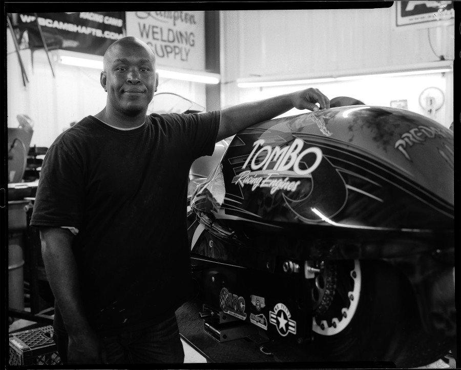 Adrian Lottie portrait with his Pro Comp drag racing motorcycle.