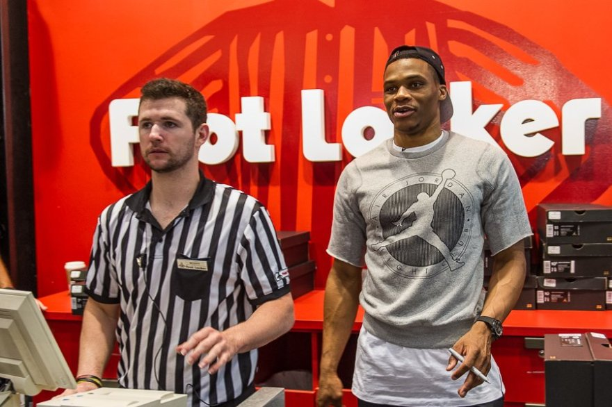 OKC Thunder star player Russell Westbrook helped run the cash register at the Foot Locker store in Quail Springs Mall.
