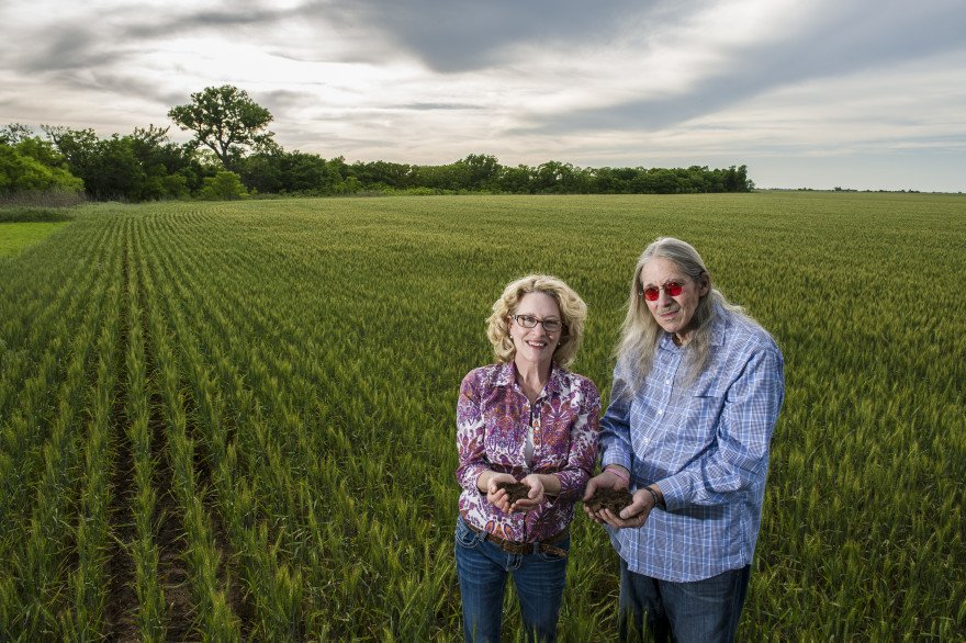 Perry and Jennifer Plett hold soil from their land on a wheat field next to their house. The land has been in the Plett family since it was homesteaded during the Cherokee Strip Land Run of 1893. The Plett's now lease some of the land to a local farmer to grow wheat.