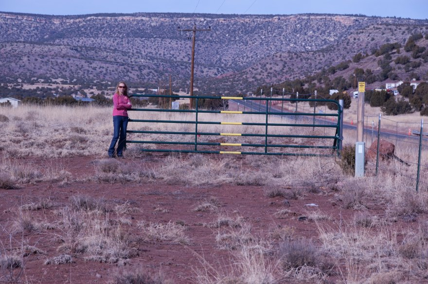 Nah. I jumped out of the Jeep and went scouting down the fence line. After a couple of hundred yards I found an unlocked gate. We had to do a bit of 4-wheeling to get to this gate, but better than back tracking all that way!