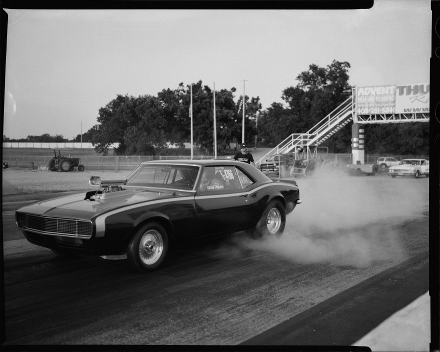 I photographed this Chevy Camaro warming up the tires in the staging area at Thunder Valley Raceway in Noble, Oklahoma. I shot this with my Toyo VX-125 4x5 film camera.