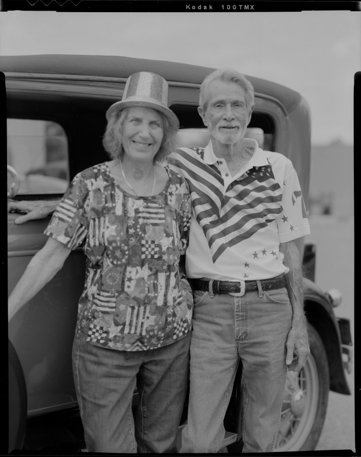 Elderly couple in front of Ford Model A automobile photographed with Toyo VX-125 film camera on Kodak TMAX-100 film.