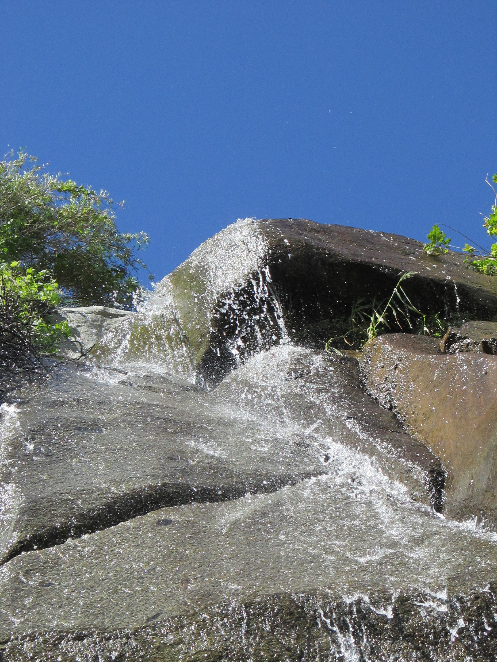 Water flowing off the top of the waterfall