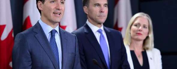 Prime Minister Justin Trudeau is joined by Finance Minister Bill Morneau National Post | James Alexander Michie