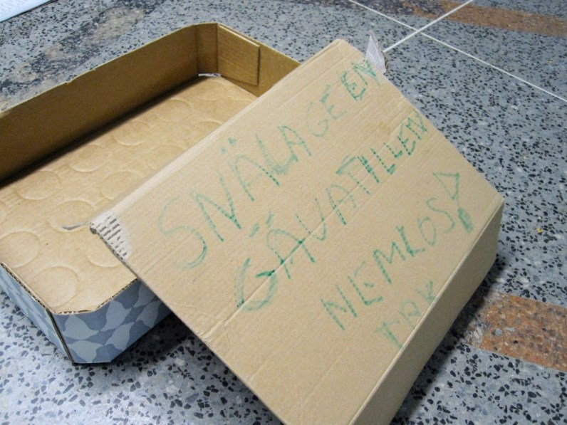 Please give to the homeless sign in Stockholm