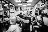 Michael & Sam feeling the razor at Alec's Hairdresser in Wright St, Adelaide