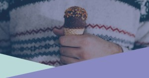 holding ice cream in a winter jumper