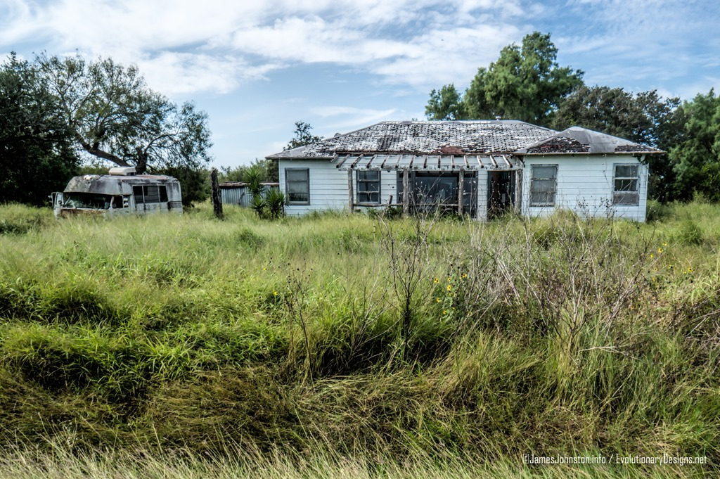 Two abandoned Farm Houses and old Ford Econline Motor Home