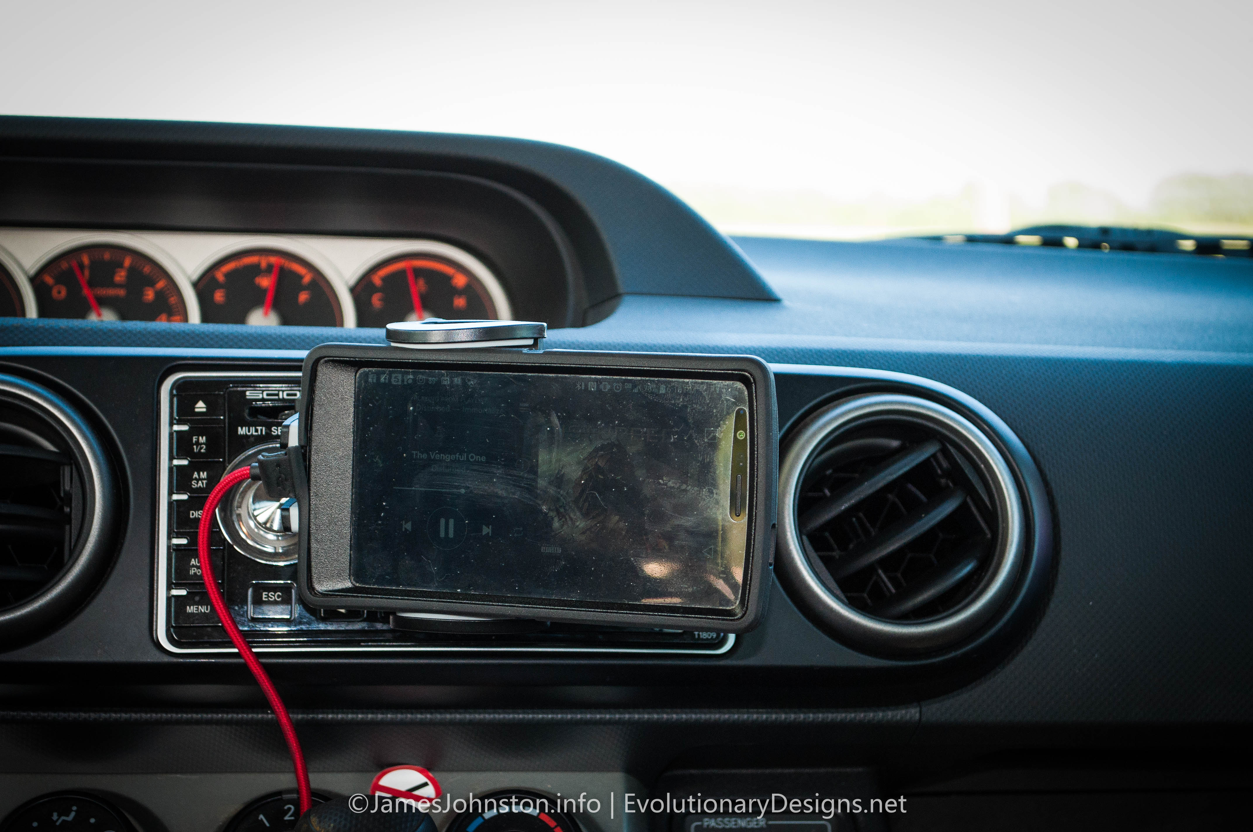 Anker CD Slot Cell Phone Mount - Used in a 2008 Scion XB  and LG G4 with Otterbox Defender Case in Horizontal mode.