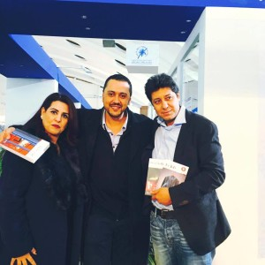 Taha Adnan and Réda Dalil and a fan (left)
