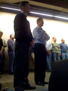 Photo of Steve Barnhart Taking the news standing by Jeff Clarke, CEO of Travelport.